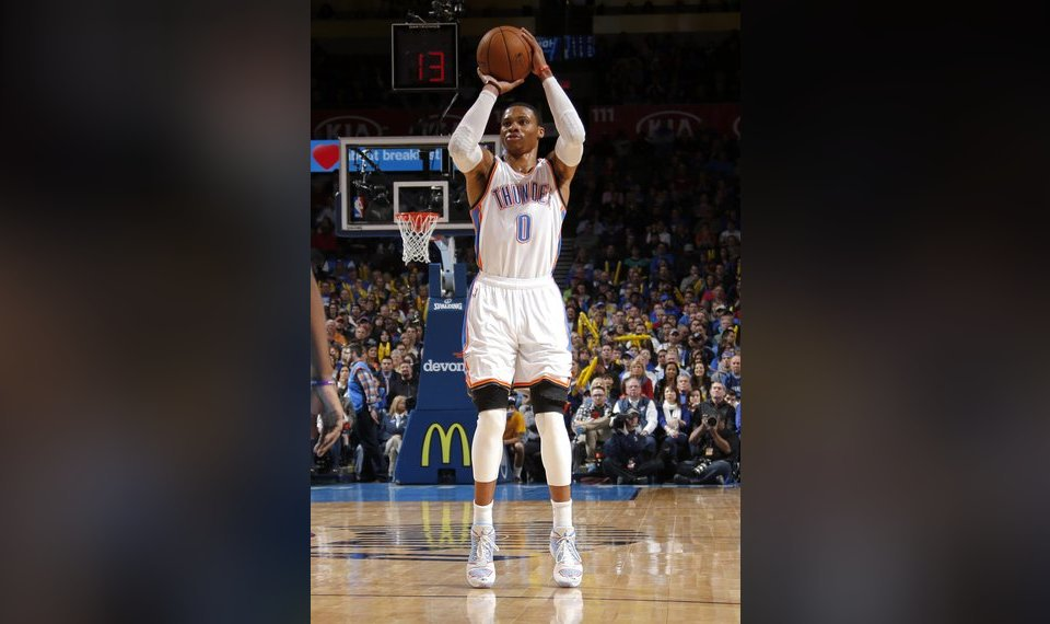 82f2aeb9a Russell Westbrook (0) shoots a three-point shot during the NBA basketball  game
