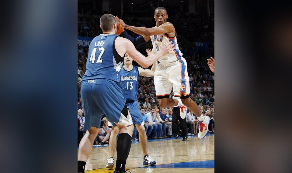 Oklahoma City s Russell Westbrook (0) passes the ball away from Kevin Love ( 42 d143f3f17