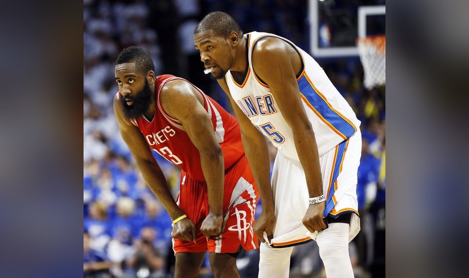 e6bb9a10 Houston's James Harden (13) and Kevin Durant (35) rest their hands on