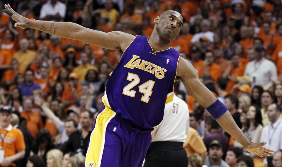 Lakers guard Kobe Bryant makes his way downcourt after scoring during his  team s 111-103 d0b27d3be