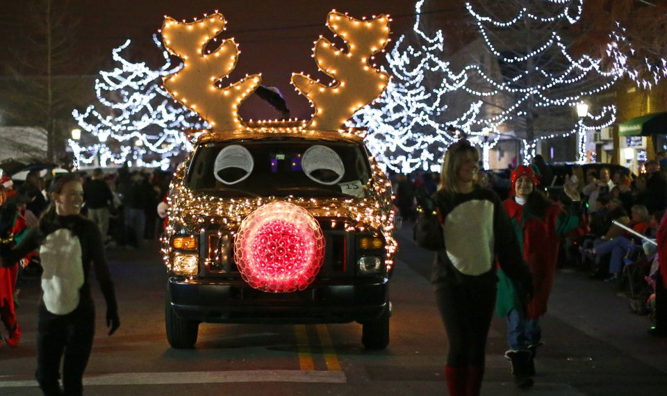 a car decorated with lights is shown saturday during the edmond electric parade of lights in