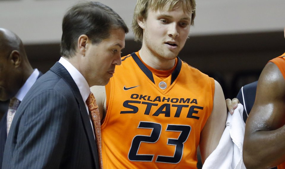 6b50deea6 Oklahoma State coach Travis Ford stands next to Alex Budke during a timeout  during the college