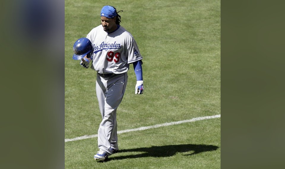 4dbf5d8b8 Related Photos Los Angeles Dodgers  Manny Ramirez tosses his helmet as he  walks back to the dugout