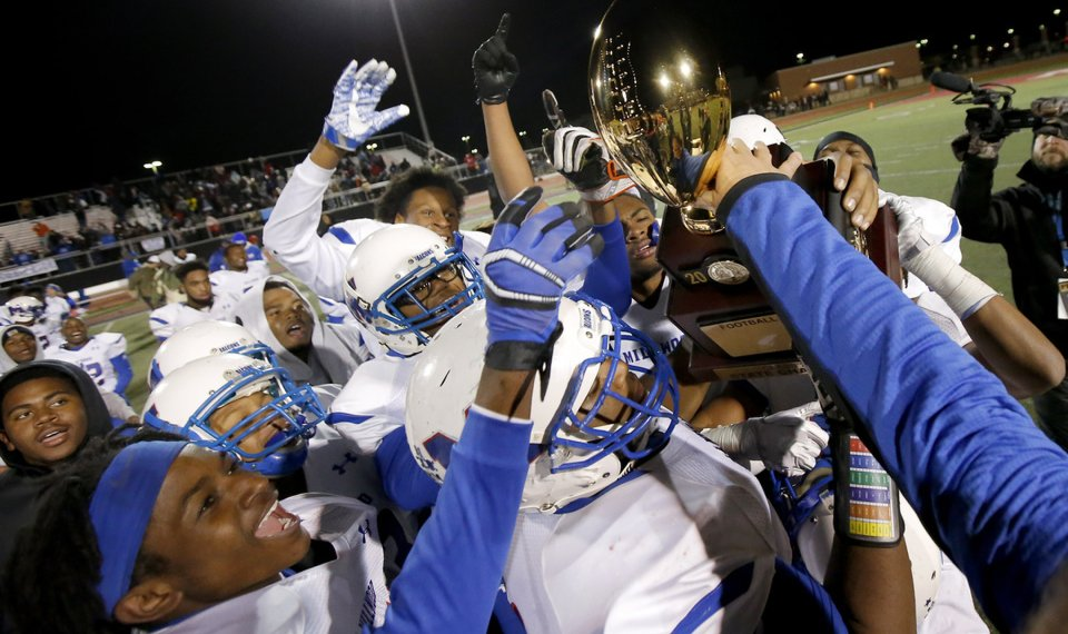 bc10f53a0 Millwood celebrates with the Class 2A state championship trophy last  season. The Falcons host Heritage