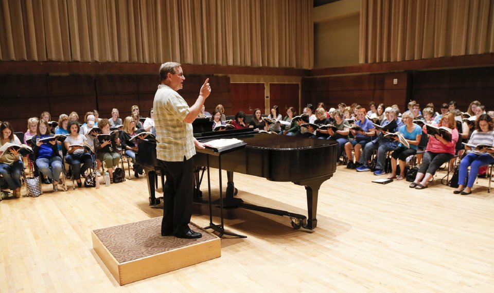 """<p>Randi Von Ellefson, artistic director, leads rehearsals for Canterbury Voices' upcoming production of Benjamin Britten's """"War Requiem"""" at Oklahoma City University's Bass Music Center in Oklahoma City. [Photo by Nate Billings, The Oklahoman]</p>"""