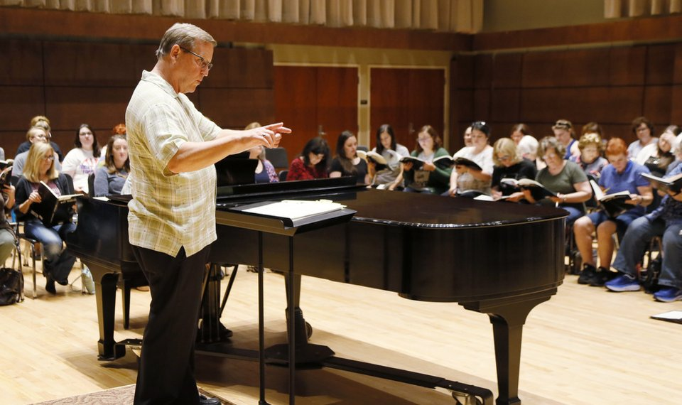 """Randi Von Ellefson, artistic director, leads rehearsals for Canterbury Voices' upcoming production of Benjamin Britten's """"War Requiem"""" at Oklahoma City University's Bass Music Center in Oklahoma City. [Photo by Nate Billings, The Oklahoman]"""
