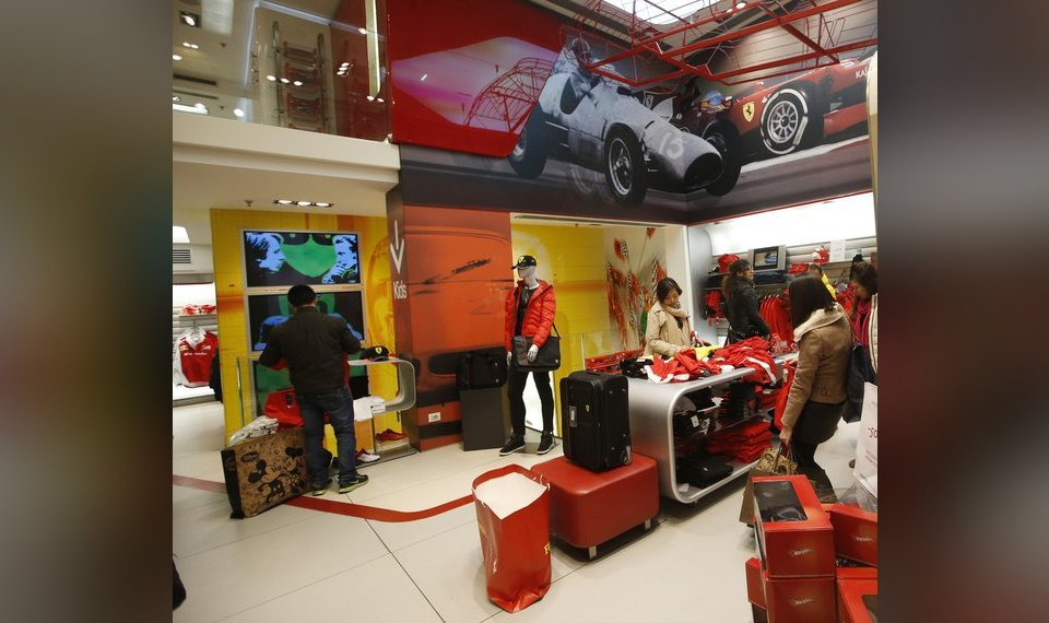 a6cfe4d09 People look at clothing in a Ferrari Store in Milan