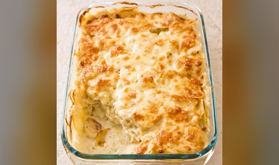 Our Creamy Scalloped Potatoes Has A Browned Cheesy Crust