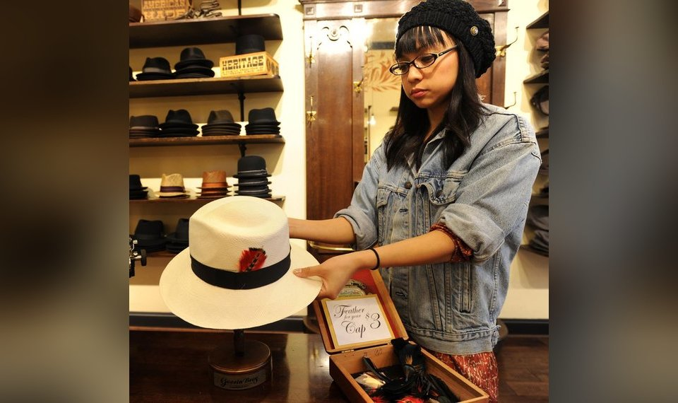 2d7839f8368 Store manager Macy Torres holds a traditional Panama hat