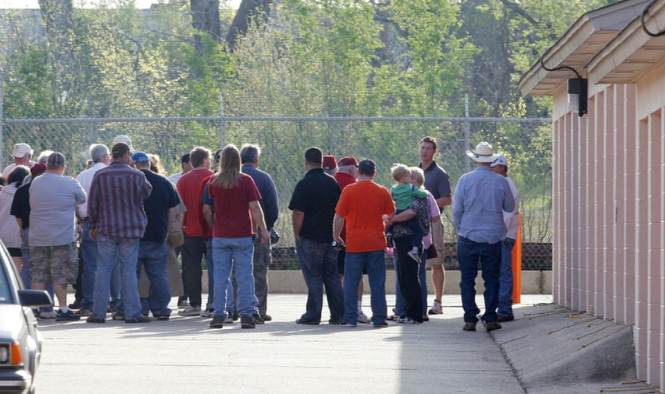 Related Photos Bidders gather Wednesday for a storage unit auction at Public Storage 8012 S Santa Fe & Oklahoma law on stored property