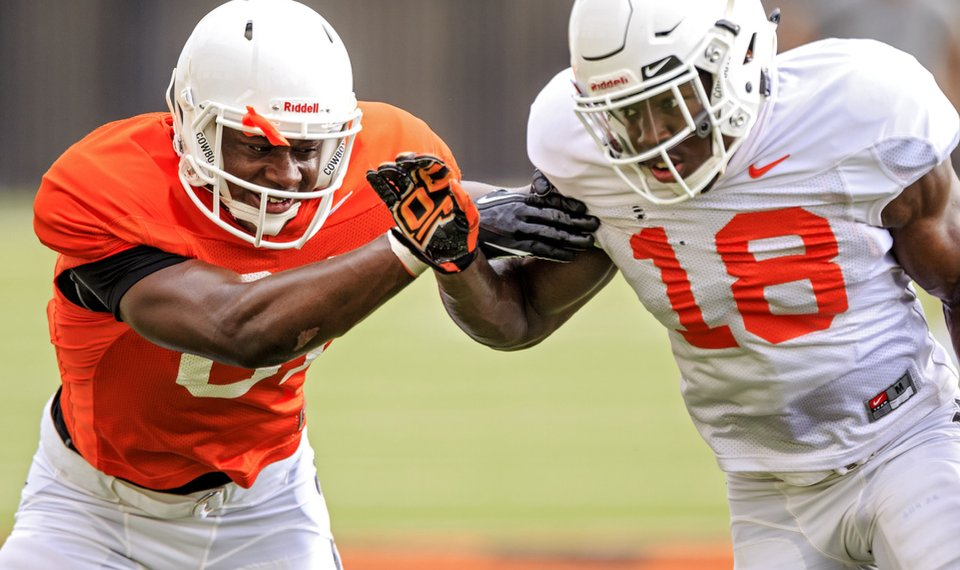 Oklahoma State receiver LC Greenwood, left, goes through a drill with defensive back Za'Carrius Green during a recent practice at the Sherman Smith Training Center. [PHOTO BY CHRIS LANDSBERGER, THE OKLAHOMAN]