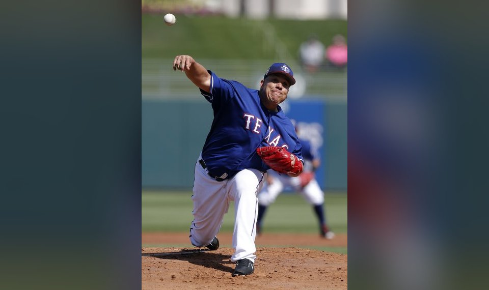 d79280e19 Texas Rangers starting pitcher Bartolo Colon throws during the second  inning of a spring training baseball