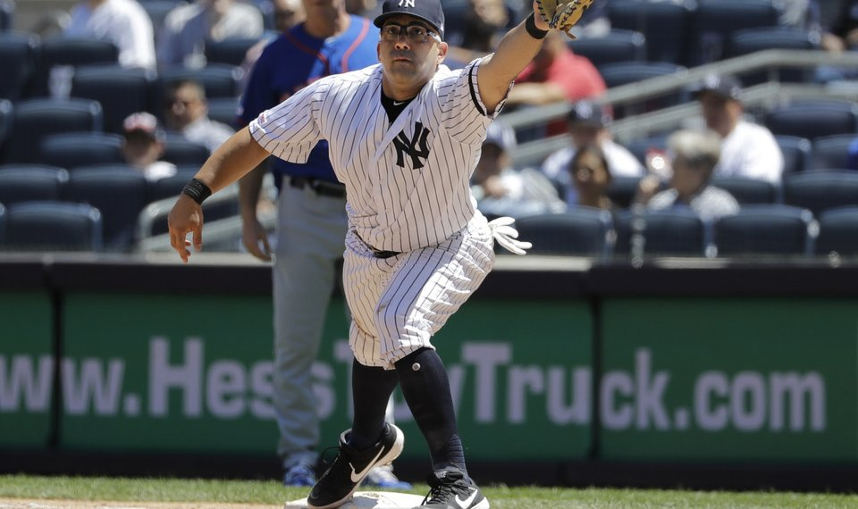091de53d3773 New York Yankees first baseman Kendrys Morales can't field the throw  allowing New York