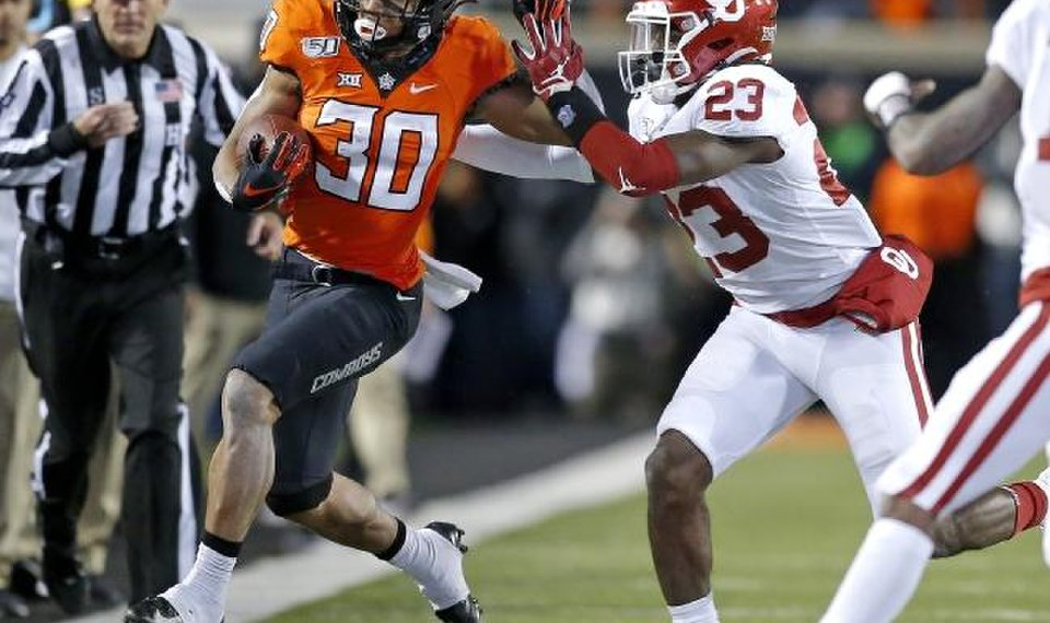 'We're going to be in the race': OSU's Mike Gundy...