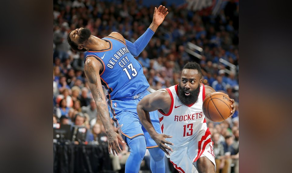 2d90d6674135 Houston s James Harden (13) is called for an offensive foul as he goes past