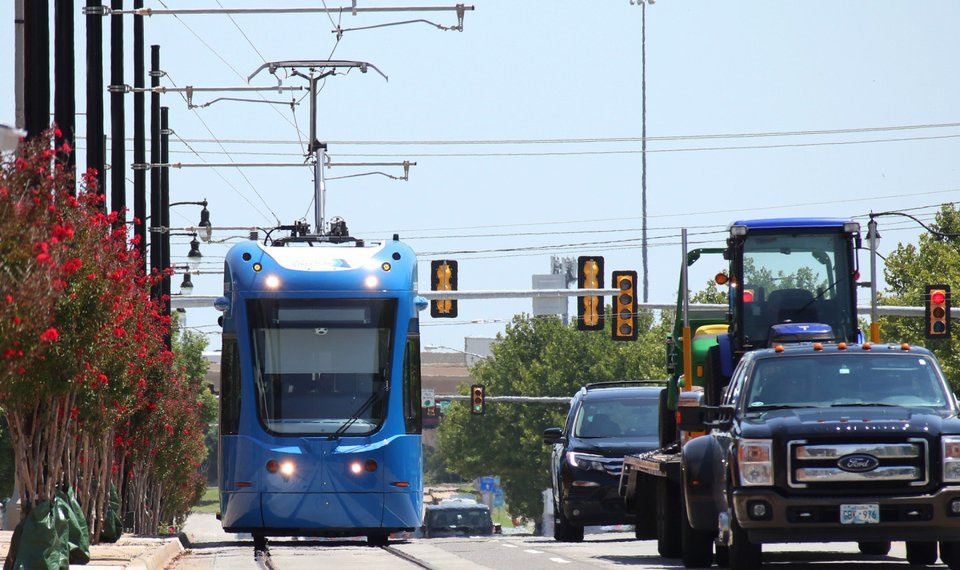 A Streetcar Travels West On Reno In Bricktown Using Overhead Electric Wires Work Continues