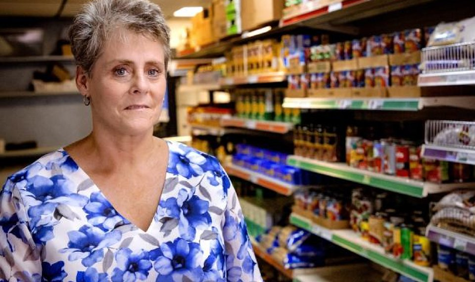 Food pantry chief sustains mom's legacy of serving HIV/AIDS...