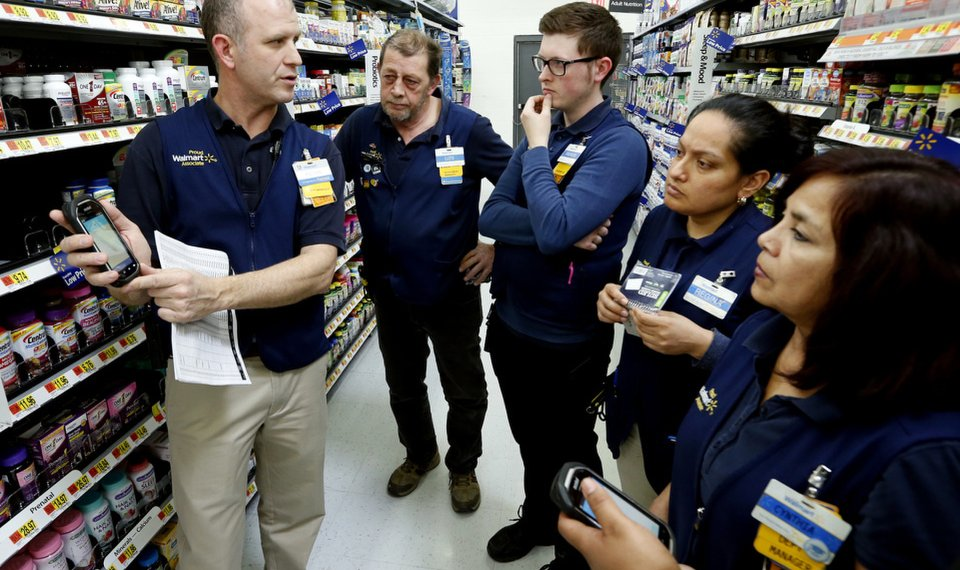 belle isle walmart trainer kevin early far left teaches a class to employees