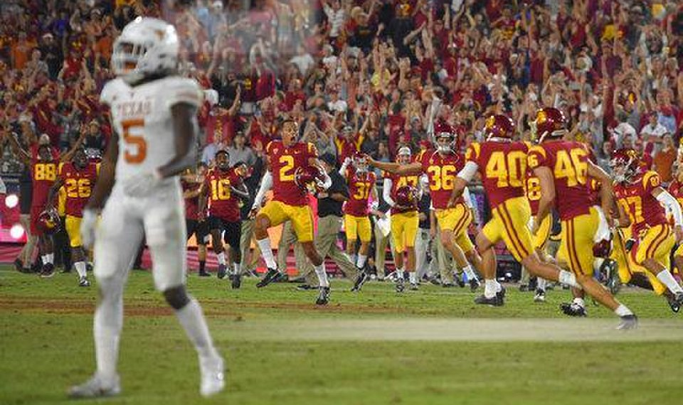 Southern Cal Players Celebrate As Texas Holton Hill Walks Off The Field Following A