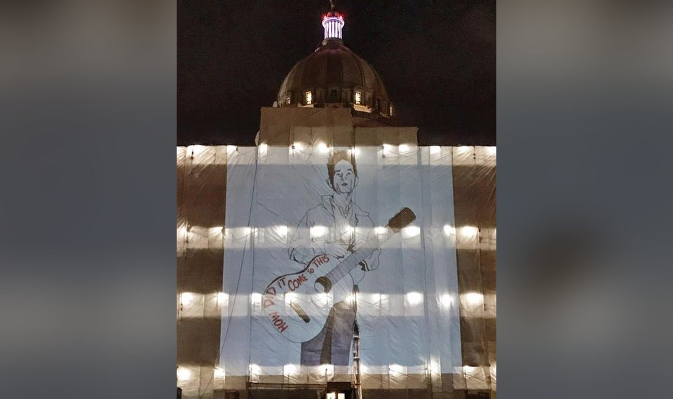 State responds to Woody Guthrie image projected onto