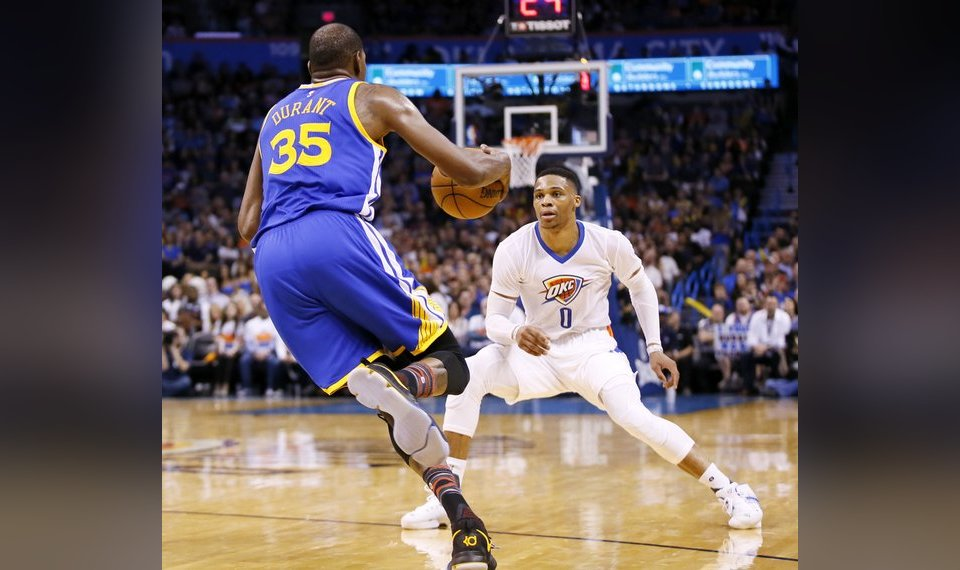 1df4beacc4cb Oklahoma City s Russell Westbrook (0) defends Golden State s Kevin Durant  (35) during