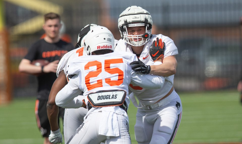 OSU using padded helmet caps during spring practices