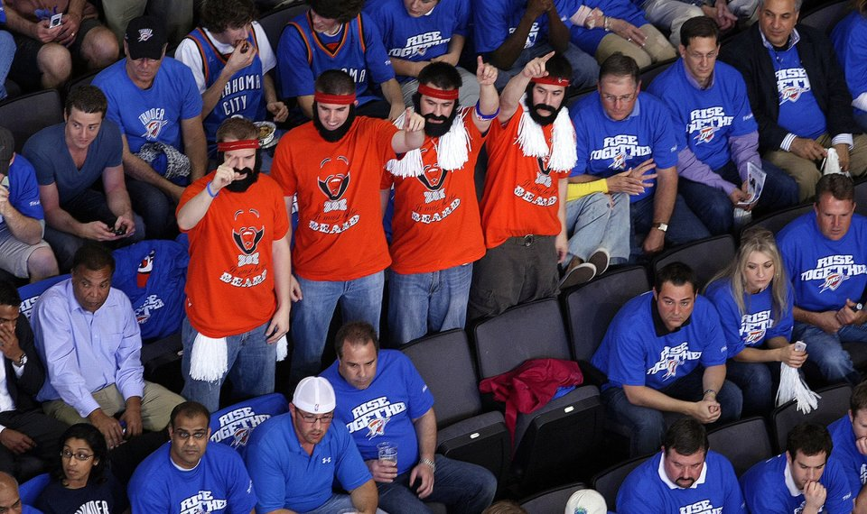 f8c9c0177af6 James Harden fans wear distinctive T-shirts and fake beards during the  Oklahoma City Thunder