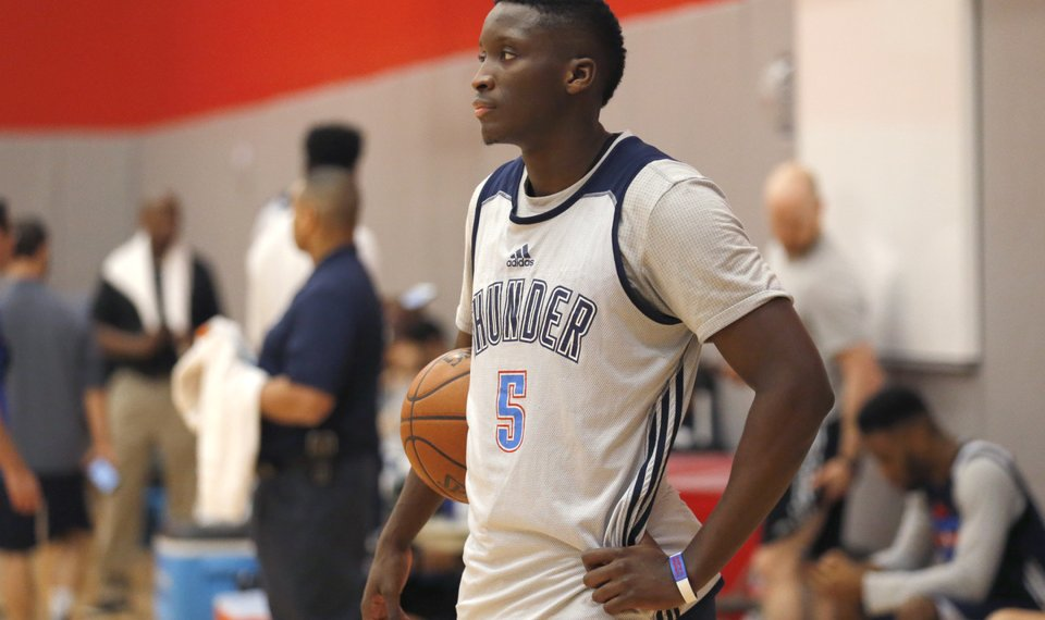 cd3016338ec2 Oklahoma City s Victor Oladipo (5) watches practice for the first round of  the NBA