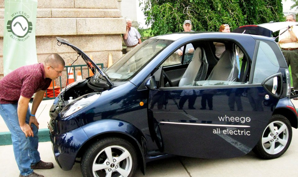 Related Photos James England Jr Checks Out The Motor Of A Wheego Electric Car