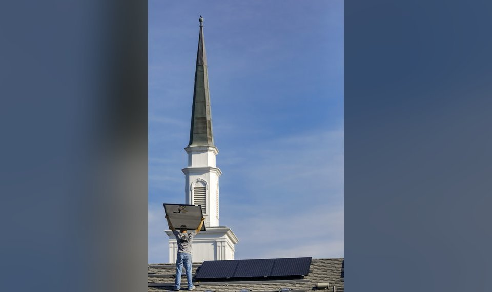 A crew installs solar panels on the roof of Mayflower Congregational Church UCC in Oklahoma City in 2016. State officials are working on issues that could expand the technology's use within Oklahoma. [hoto by Chris Landsberger, The Oklahoman Archives]