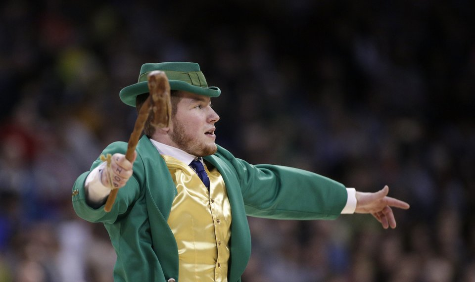 301f0a272260 The Notre Dame mascot stands on the court during the second half in a regional  final