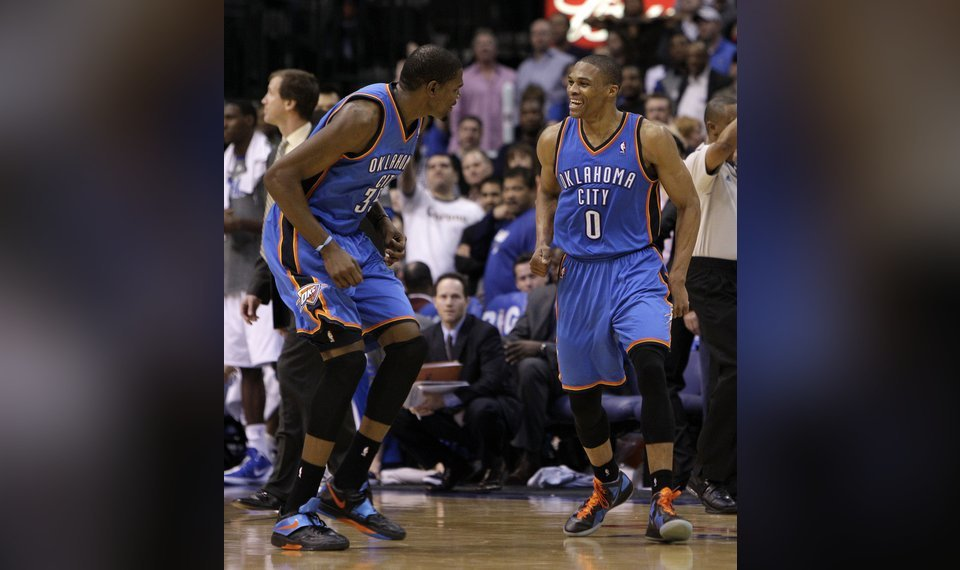 separation shoes 47525 a45d7 CELEBRATION  Oklahoma City Thunder s Kevin Durant, left, and Russell  Westbrook, right,