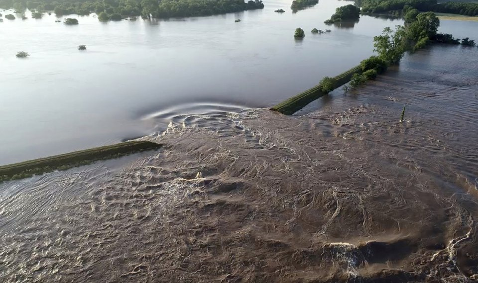 In This Aerial Image Provided By Yell County Sheriff S Department Water Rushes Through The Levee Along