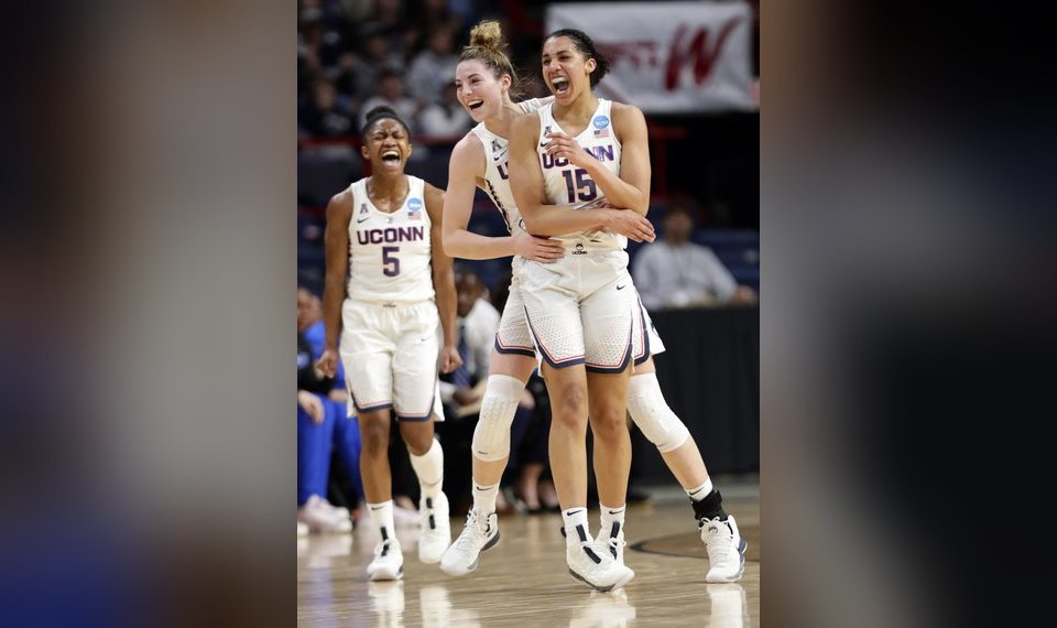 9e7ba353bbf0 UConn s Crystal Dangerfield (5) and Katie Lou Samuelson celebrate a 3-point  basket