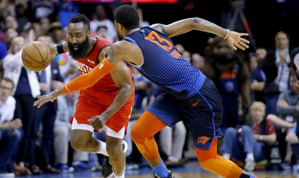 d155759ed4ca Houston s James Harden (13) looks to get by Oklahoma City s Paul George (13