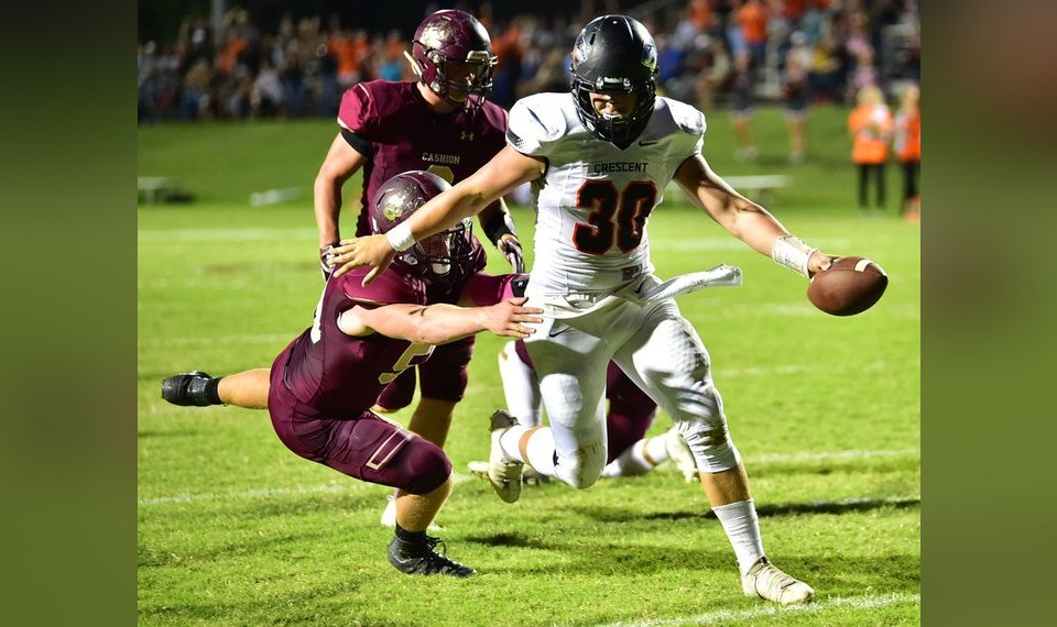 6ae9078a0 Crescent s Hunter Bowers breaks a tackle as he scores a touchdown against  Cashion last season.