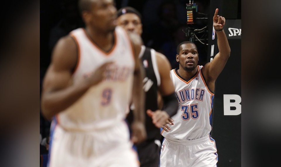 4dbd9f58d67 Oklahoma City Thunder s Kevin Durant points after scoring during the second  half of an NBA basketball