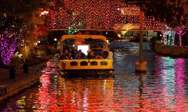 people enjoy the free canal boat rides under the holiday lights during the onemain financial lights - Lead Free Christmas Lights