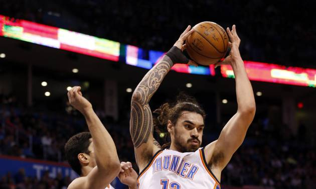 Steven Adams, with Enes Kanter alongside, pulls down a rebound against the Clippers on New...
