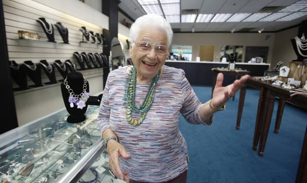 In this photo made Wednesday, Oct. 19, 2011, Maxine Bennett, 91, laughs during an interview at her jewelry store in Dallas. Bennett is part of a growing number of people who continue working way past the usual retirement age. (AP Photo/LM Otero)