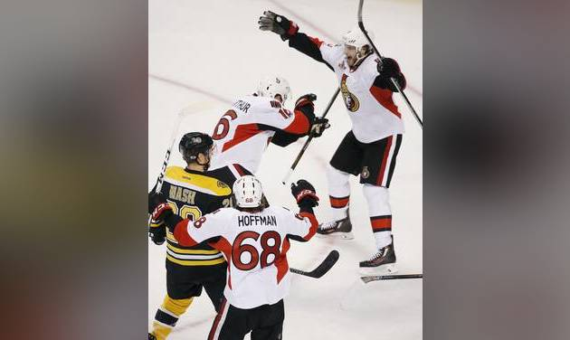 Ottawa Senators&#039 Clarke Mac Arthur celebrates his goal with teammate Bobby Ryan as Boston Bruins&#039 Riley Nash looks on during overtime in game six of a first-round NHL hockey Stanley Cup playoff series Sunday