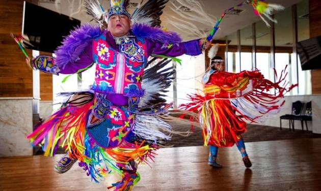 Native American dancers Cecil Gray and Courtney Reeder perform during a Red Earth press conference at the Petroleum Club in Oklahoma City, Okla....