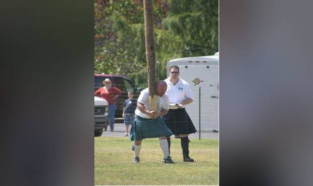 Jonathan Irvin, athletic director of the United Scottish Clans of Oklahoma, competes in the caber toss at the Iron Thistle Scottish Festival in Yukon. STAFF PHOTO BY DAVID CHRISTOPHER