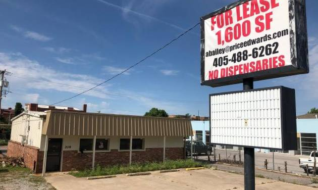 """A building in Midtown displays a """"NO DISPENSARIES"""" sign on its marquee. Brokers and developers in the Oklahoma City metro have varying levels of..."""