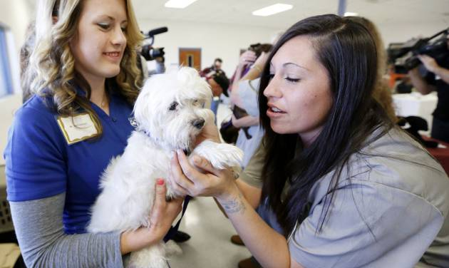 Central Oklahoma Humane Society\'s Amy Shrodes, left, introduces Lady to Mabel Bassett...