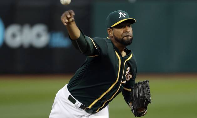 Oakland Athletics starting pitcher Cesar Valdez throws to a Seattle Mariners batter during the second inning of a baseball game Thursday