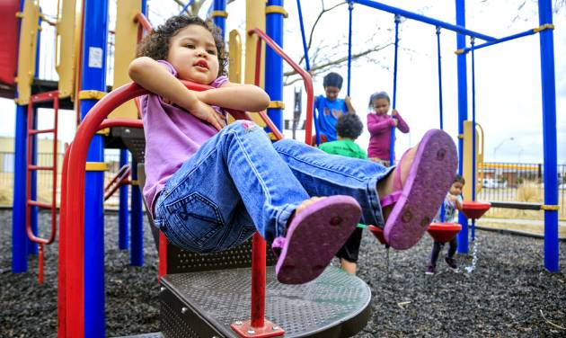 A child of a client at the City Rescue Mission plays on the shelter\'s playground Monday...