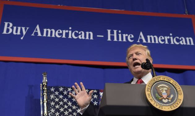 Trump signs order to implement 'Buy American, Hire American'