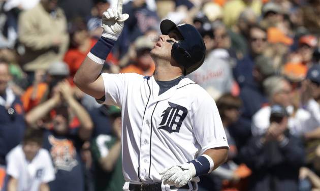 Detroit Tigers&#039 James Mc Cann looks skyward after scoring on his solo home run during the fifth inning of a baseball game against the Boston Red Sox Saturday