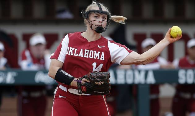 OU\'s Paige Lowary throws to first base the NCAA softball game between the University of Oklahoma...